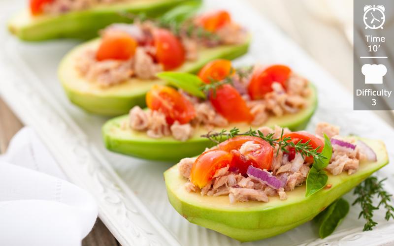 Avocado stuffed with tuna and herbs